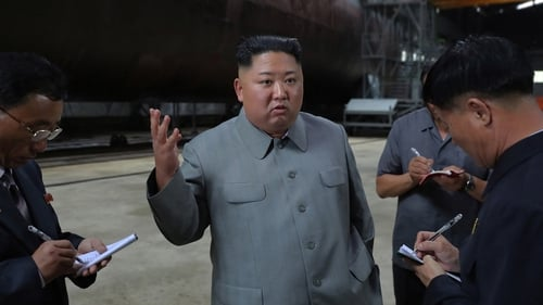 North Korean leader Kim Jong-un after inspecting a newly-laid down submarine earlier this week