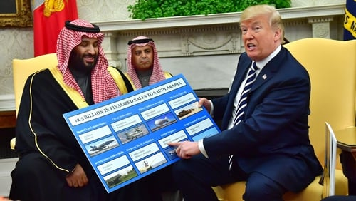 President Trump holds a defence sales chart with Saudi Arabia's Crown Prince Mohammed bin Salman at the White House