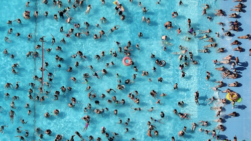 People cool down on a hot July day in Germany last year