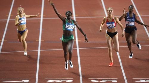 Rhasidat Adeleke celebrates as she crosses the line