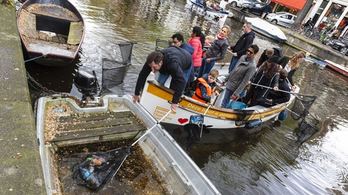 Volunteers fish the plastic out of the canals in Amsterdam