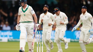 England celebrate taking the wicket of Kevin O'Brien