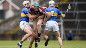 Ronan (L) and Brendan Maher (R) tackle Cathal Mannion in the 2017 League final