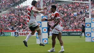Timothy Lafaele of Japan celebrates his try with team mate Pieter Labuschagne