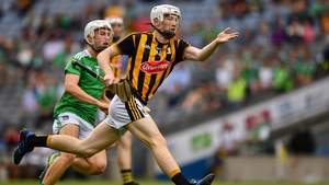 Timmy Clifford of Kilkenny evades Jimmy Quilty of Limerick