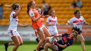 Martina O'Brien of Cork makes a save despite the shot of Blaithin Mackin of Armagh