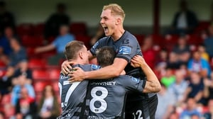 Dundalk players celebrate Mountney's goal