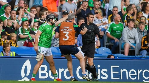 Darragh O'Donovan and a Limerick official appeal to linesman Patrick Murphy after the sideline was ruled wide