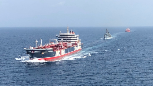 The Stena Important being accompanied by the British Navy through the Strait of Hormuz on 25 July