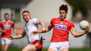 Colm O'Callaghan of Cork in action against Conall Devlin of Tyrone
