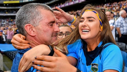 Sheedy celebrates with his daughter Aisling after the final whistle
