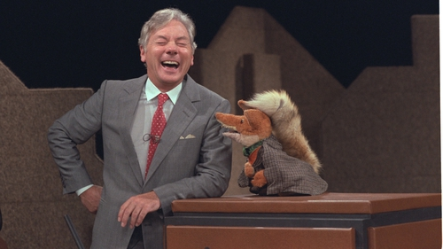 Gay Byrne shares a joke with Basil Brush on the The Late Late Show in 1983