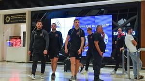 Dundalk players, from left, Patrick Hoban, Michael Duffy arrive at Heydar Aliyev International Airport in Baku