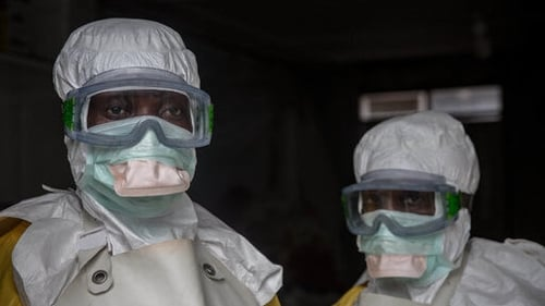 Medical staff in Goma wearing protective gear before entering an isolation area at an Ebola treatment centre