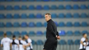 Dundalk head coach Vinny Perth assesses training at Dalga Arena in Baku, Azerbaijan