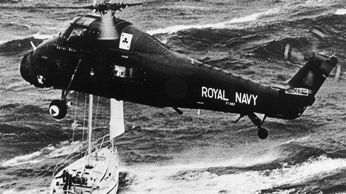 A Royal Navy helicopter rescues the crew of the yacht Camargue after the disastrous Fastnet yacht race in which 85 yachts went missing in force eleven hurricane winds, 14th August 1979. Photo credit; Steven Pratt/Getty Images