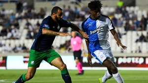 Roger Tamba M'Pinda of Apollon Limassol in action against Ethan Boyle of Shamrock Rovers