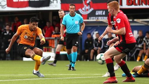 Raul Jimenez (L) scores Wolves' third goal