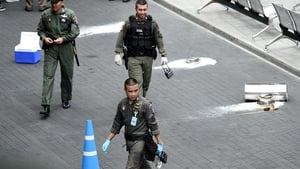 Thai bomb disposal experts at the scene of one of the blasts
