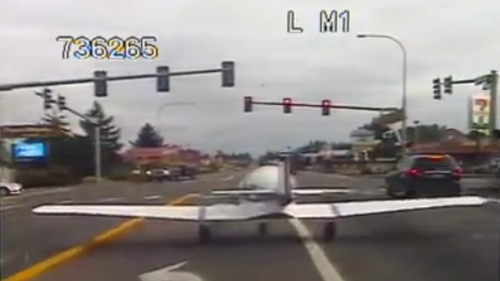 Plane lands on busy USA  highway