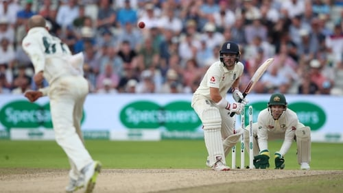 Australia's Nathan Lyon bowls the last ball of the day to Rory Burns