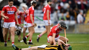 Evan Shefflin of Kilkenny is consoled by Cork's Simon Kennefick