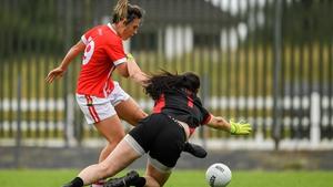 Doireannn O'Sullivan shoots past the Tyrone goalkeeper Shannon Lynch