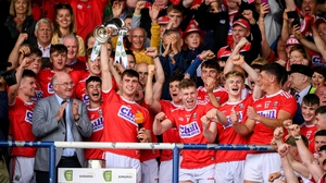 Cork captain Peter O'Driscoll and team-mates
