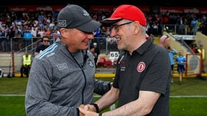 Jim Gavin, left, and Mickey Harte embrace after the full-time whistle in Healy Park