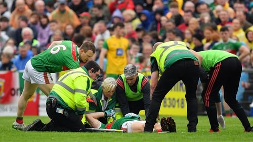 Jason Doherty is attended to by medical personnel at MacHale Park