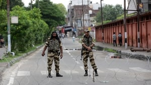 Indian soldiers stand guard in Kashmir to deter protests over scrapping the regions special status