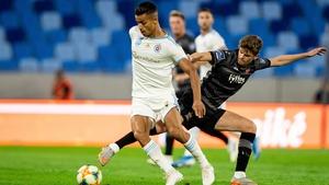 Mohammed Rharsalla of Slovan Bratislava battles with Sean Gannon