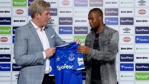 Djibril Sidibe (R) with Everton director of football Marcel Brands