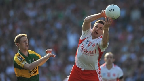 Conor Gormley gets to the ball ahead of Colm Cooper in the 2008 All-Ireland final
