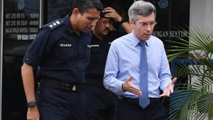 France's Ambassador to Malaysia Frederic Laplanche (r) meet the police coordinating the search operation