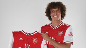 David Luiz poses in his Arsenal shirt