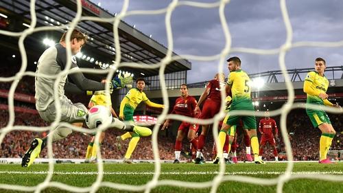 Virgil van Dijk of Liverpool scores