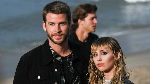 "Liam Hemsworth with Miley Cyrus (photographed in June in Malibu, California) - ""I wish her nothing but health and happiness going forward"""