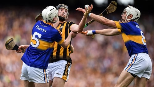 Walter Walsh is tackled by Séamus Kennedy (L) and Brendan Maher (R) in the 2016 final