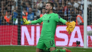 Adrian celebrates saving Tammy Abraham's penalty