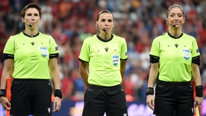 Referee Stephanie Frappart (C) looks on with assistant referees, Manuela Nicolosi (R) and Michelle O'Neill