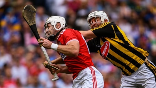 Walsh gets a tackle in on Cork's Horgan