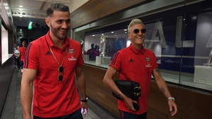 Sead Kolasinac (L) and Mesut Ozil were unavailable for selection for the season opener at Newcastle.