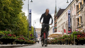 A cyclist in Oslo, a city slowly but surely reducing the number of cars in its city centre. Photo: Fredrik Varfjell/AFP/Getty Images