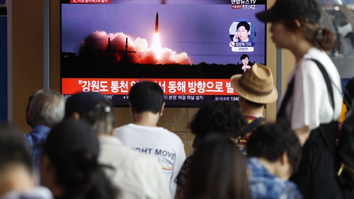South Korean people watch a breaking news broadcast about North Korea's missile launch
