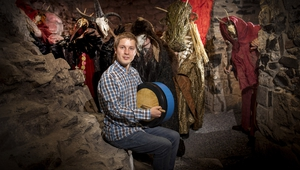 Bodhran player Kevin Meehan (centre) and assorted spooky creatures at the launch of Púca