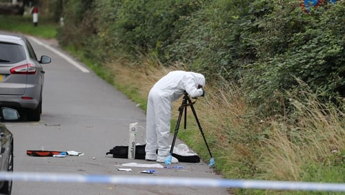 Forensic investigators gathering evidence on the road