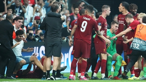 Adrian (green shirt) being helped by teammates after a pitch invader (L jeans shorts) rushed into him at the end of the penalty shootout