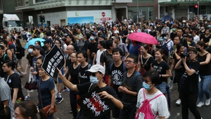 Several thousand teachers and their supporters have marched in Hong Kong