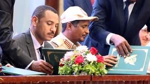 Ahmad al-Rabie and Mohamed Hamdan Dagalo sign the agreement in Khartoum